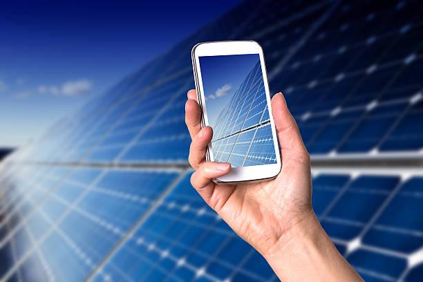 Smartphone showing blue solar panels stock photo