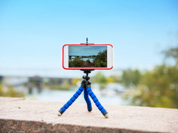 smartphone stands on a tripod stock photo