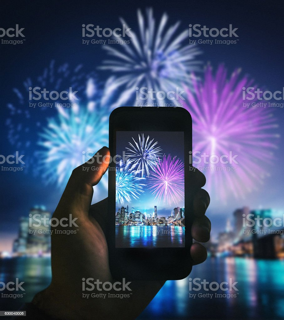 smartphone take a pic of the nyc celebration stock photo