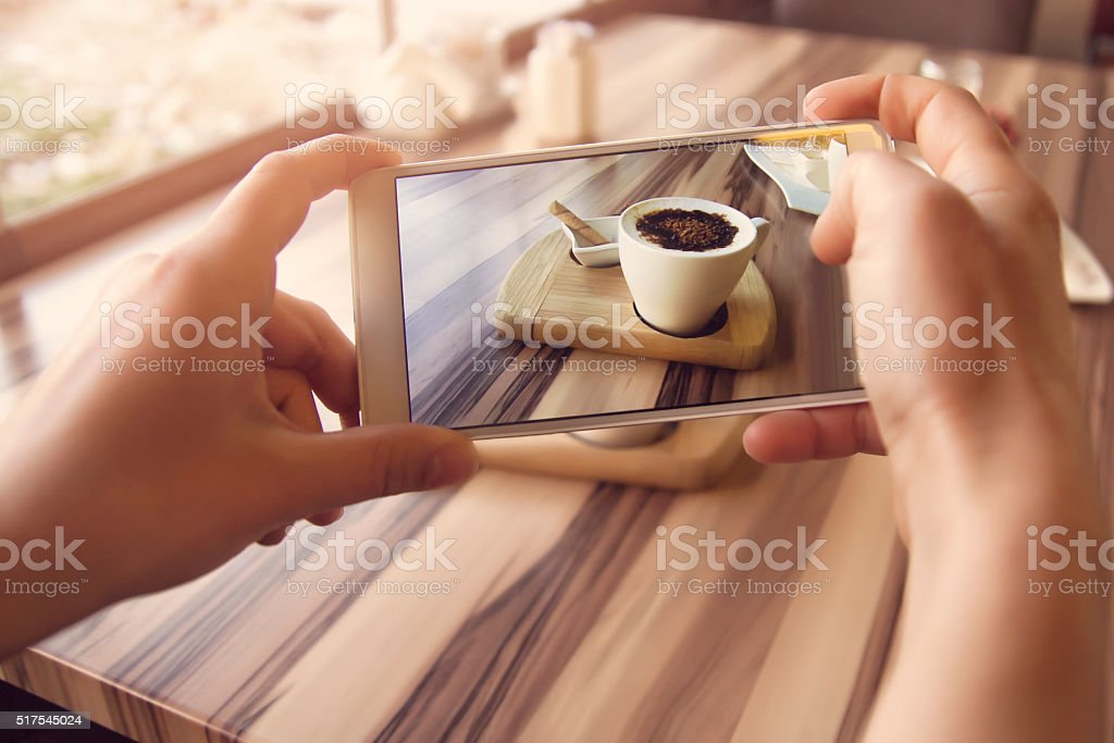 Smartphone taking picture from a coffee stock photo