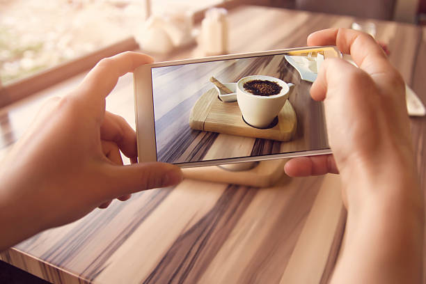 Smartphone taking picture from a coffee Smartphone taking picture from a coffee taken on mobile device stock pictures, royalty-free photos & images