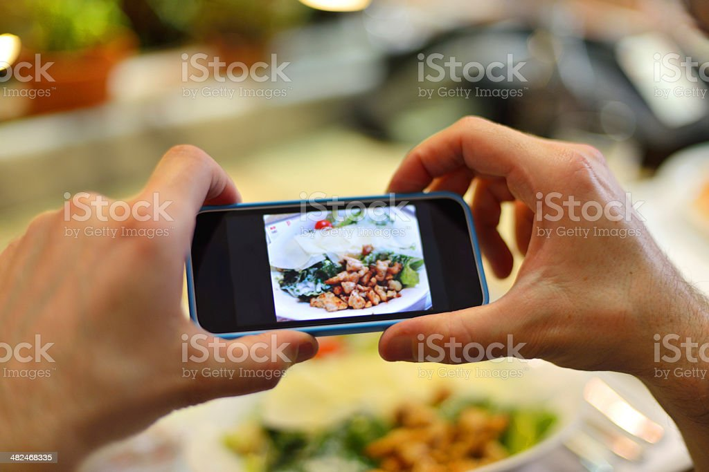 Smartphone taking picture from salad royalty-free stock photo