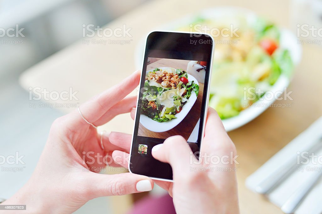Smartphone taking picture from salad stock photo