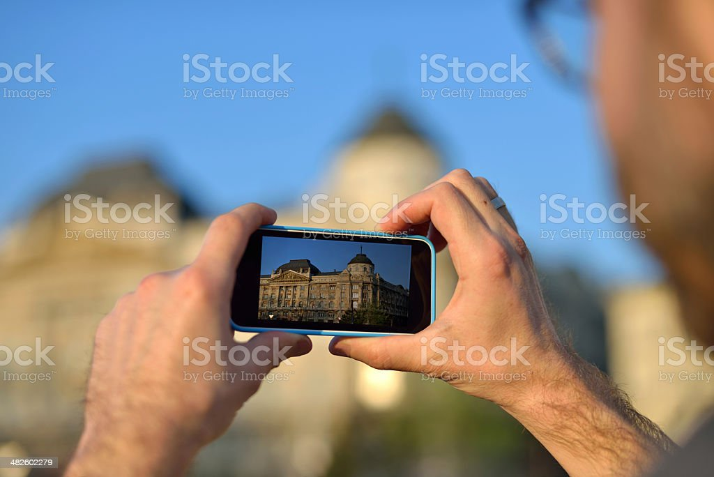 Smartphone taking picture of the city royalty-free stock photo
