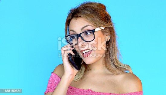 538883870istockphoto Smartphone talk, positive expression 1138159672