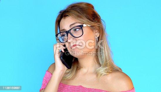 538883870istockphoto Smartphone talk, positive expression 1138159881