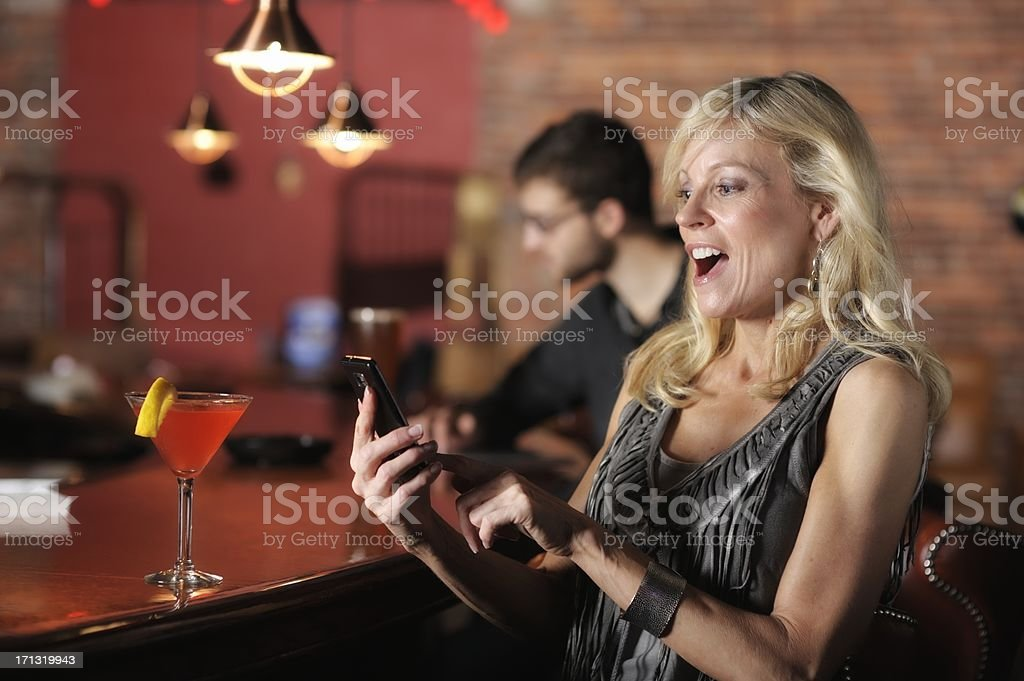 Smartphone Texting Fun in a Bar stock photo