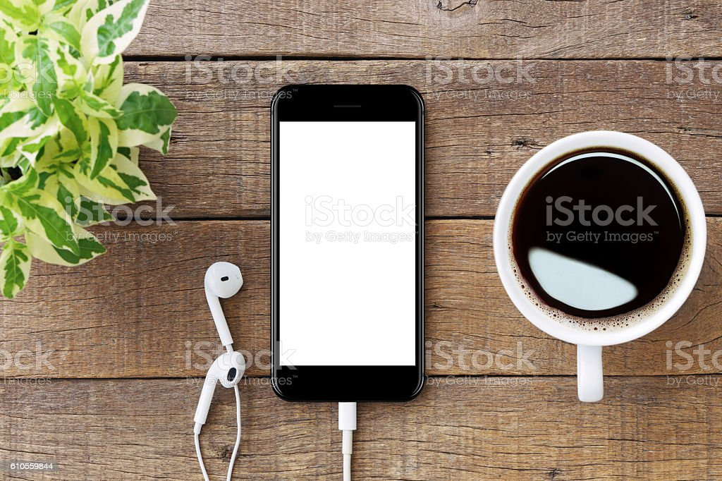 smartphone white screen on wooden table stock photo