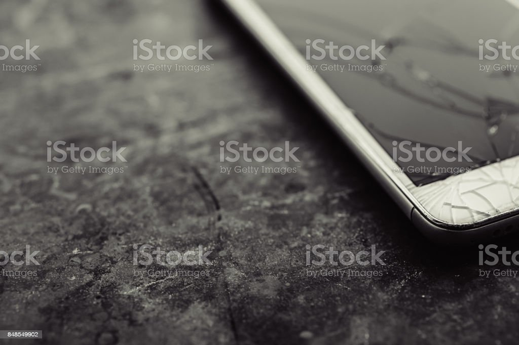 Smartphone with a broken screen. stock photo
