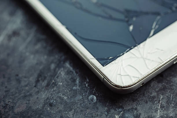 smartphone with a broken screen. - broken iphone stock photos and pictures