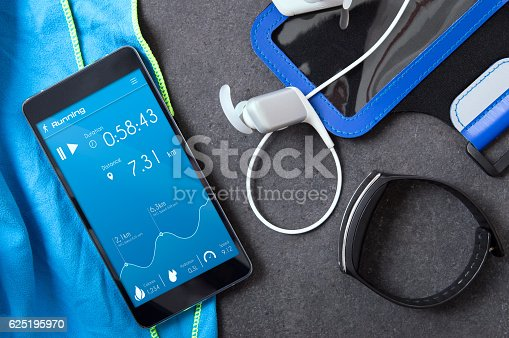istock Smartphone with an unknown application for runners on the stone. 625195970