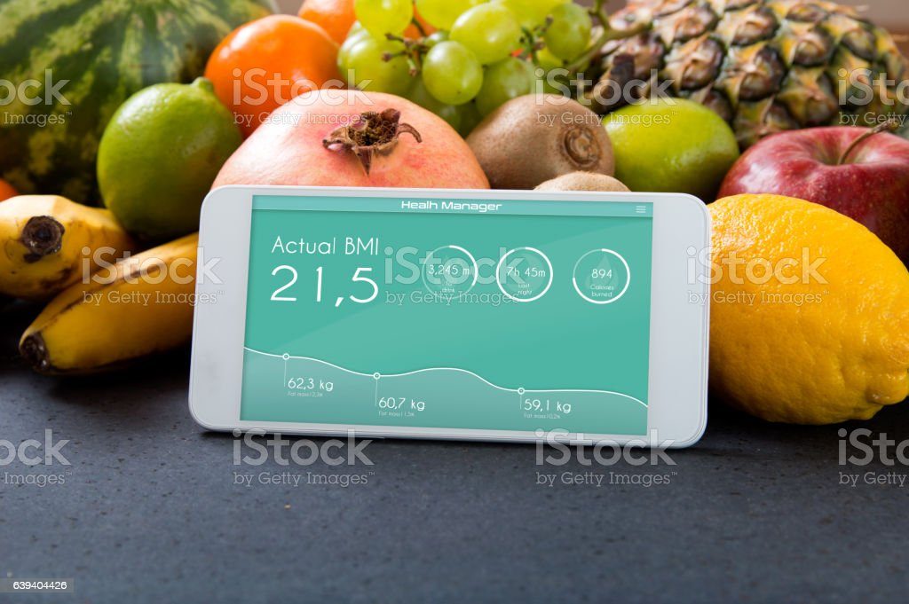Smartphone with app showing BMI. stock photo