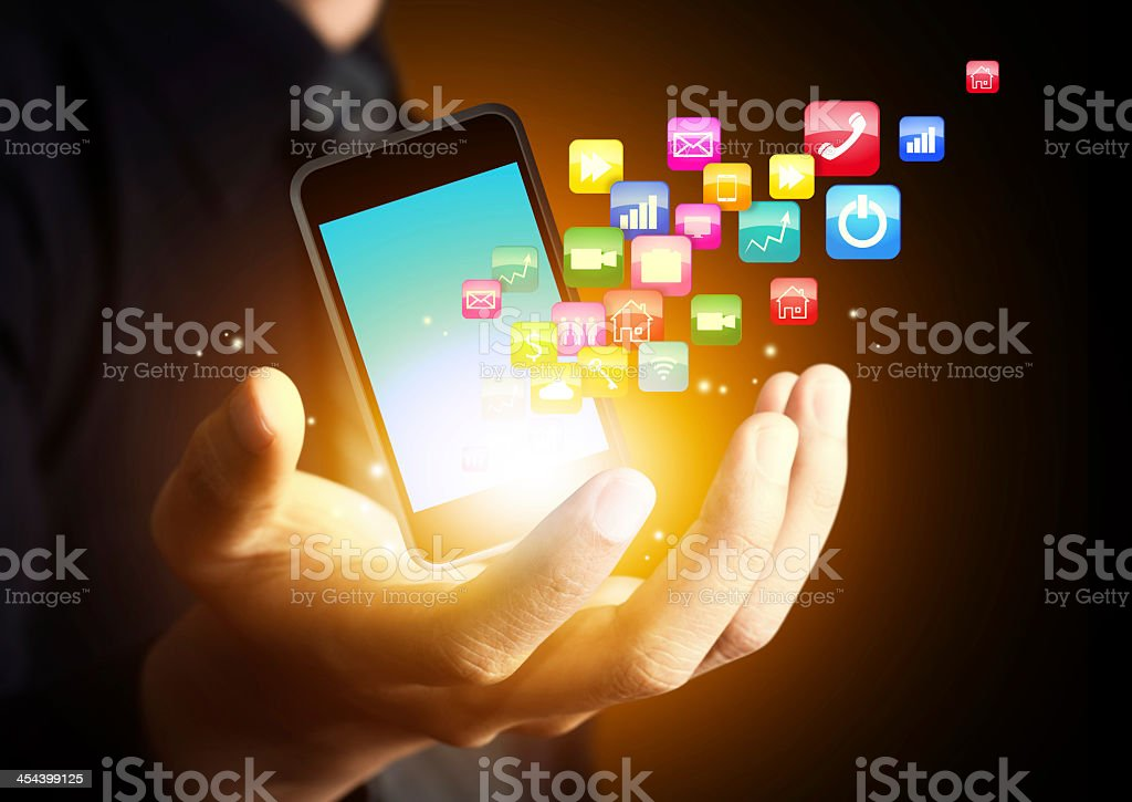 Smartphone with application icons floating off the screen stock photo
