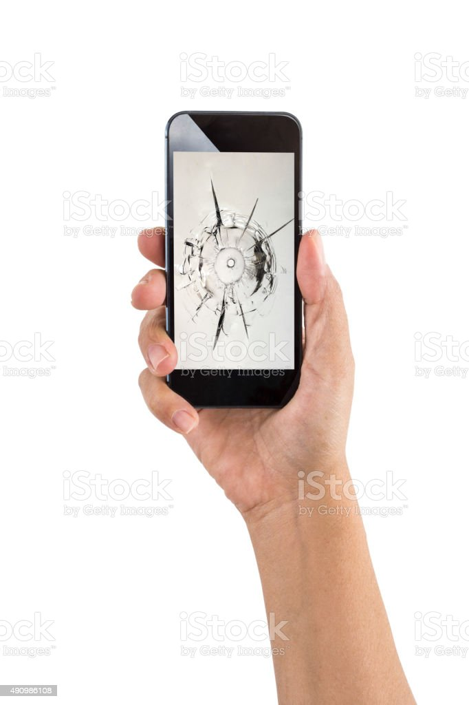 Smartphone with bullet holes stock photo