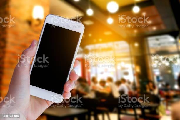 Smartphone with coffee shop picture id685461130?b=1&k=6&m=685461130&s=612x612&h=13hnpw dc2axjnf am2k6cqd x6ggdeeyesr9aarr u=