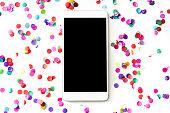istock Smartphone with confetti 1063835410