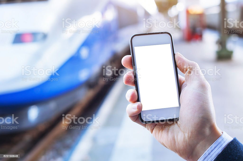 smartphone with empty blank screen in train station stock photo