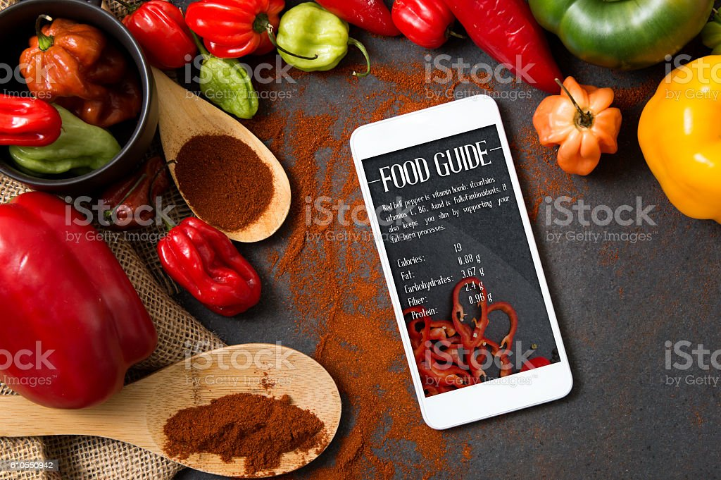 Smartphone with Food Guide application lying on stone countertop stock photo