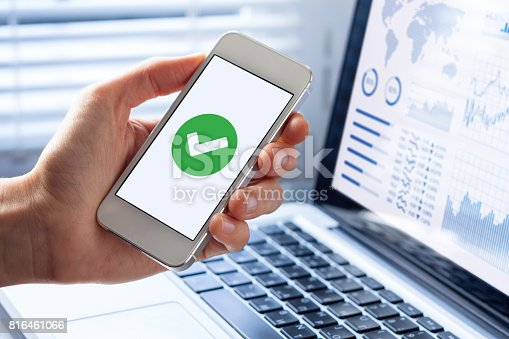 istock Smartphone with green checkmark on screen, validated, confirmed, completed, approved 816461066