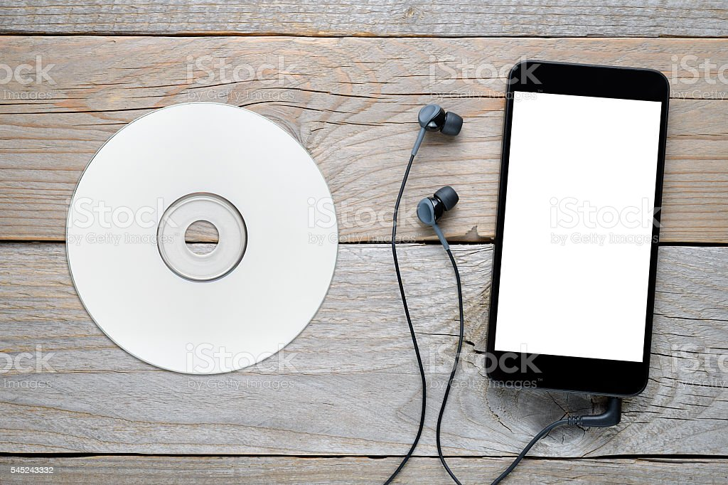 Smartphone with headphones and CD stock photo