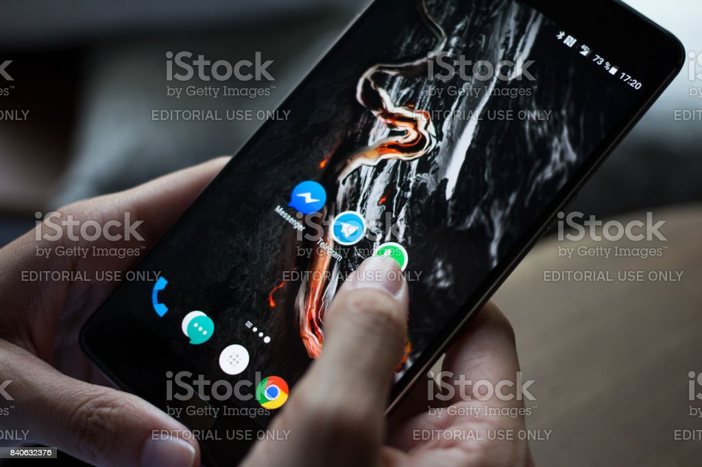 Smartphone with icons of social media on screen stock photo