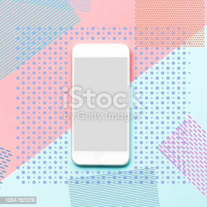 istock Smartphone with memphis color art background.flat lay minimal style 1004782026