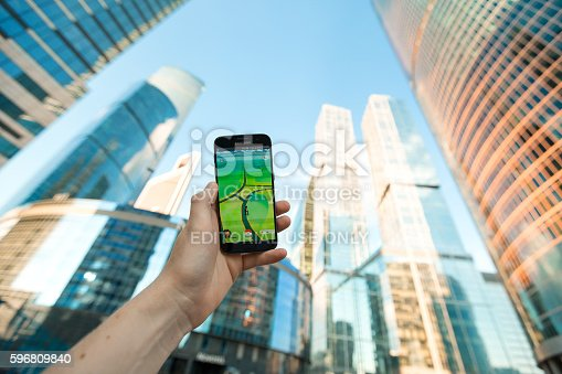 istock Moscow, Russia - August 21, 2016: Smartphone with Pokemon Go 596809840