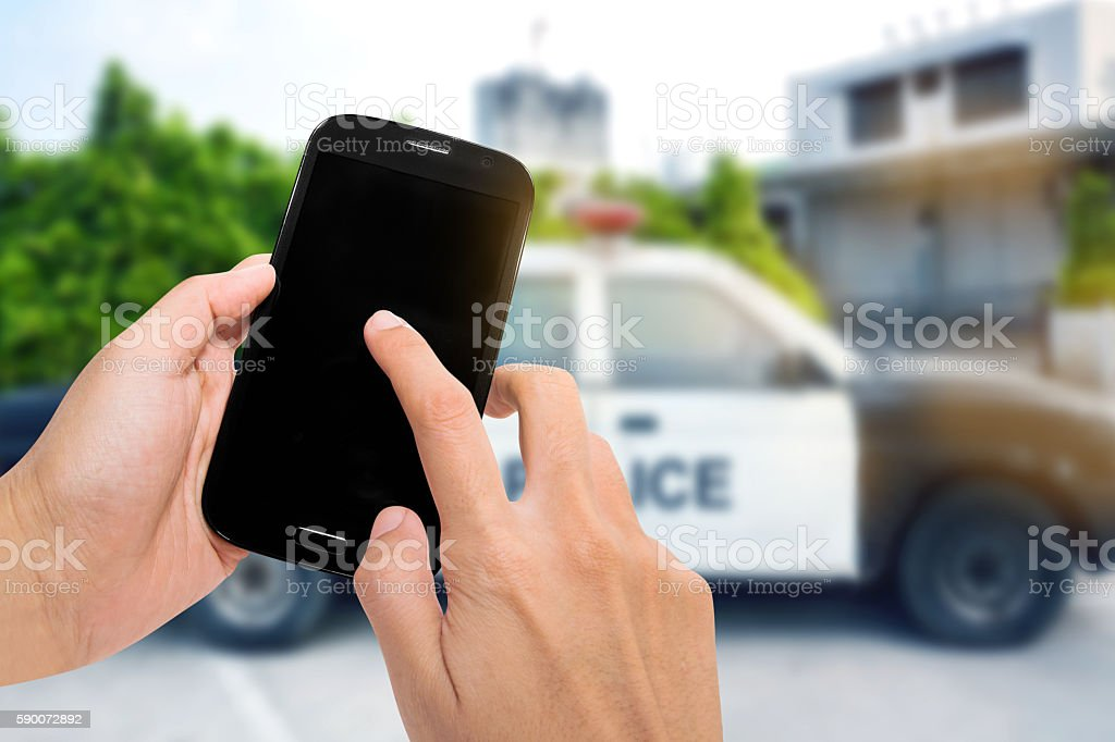 Smartphone with police car. stock photo