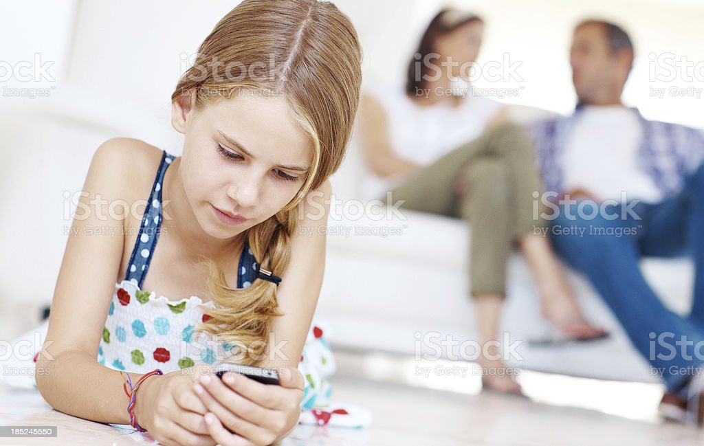 Smartphones keep her connected at all times royalty-free stock photo