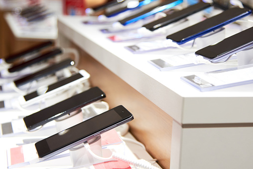 Smartphone's on the counter of a modern electronics store