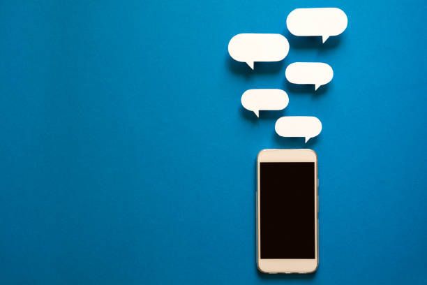 Smartphones with paper speech bubbles on blue background concept picture id959573422?b=1&k=6&m=959573422&s=612x612&w=0&h=jmngtcddtz0fieuui 8zlqqcfyhjeaqnwcpbnp5twqc=