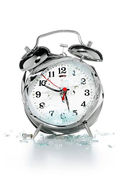 Smashed alarm clock stock photo