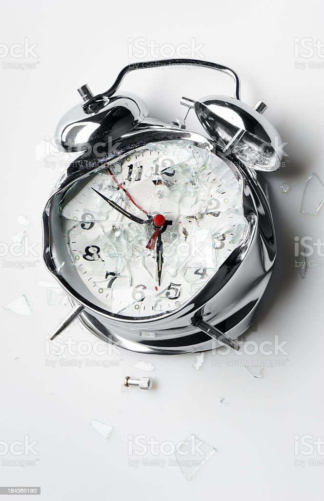 Smashed alarm clock stock photo