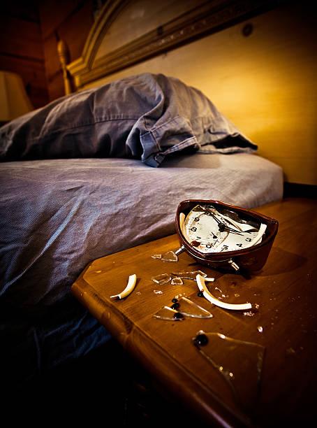 smashed annoying alarm clock stock photo