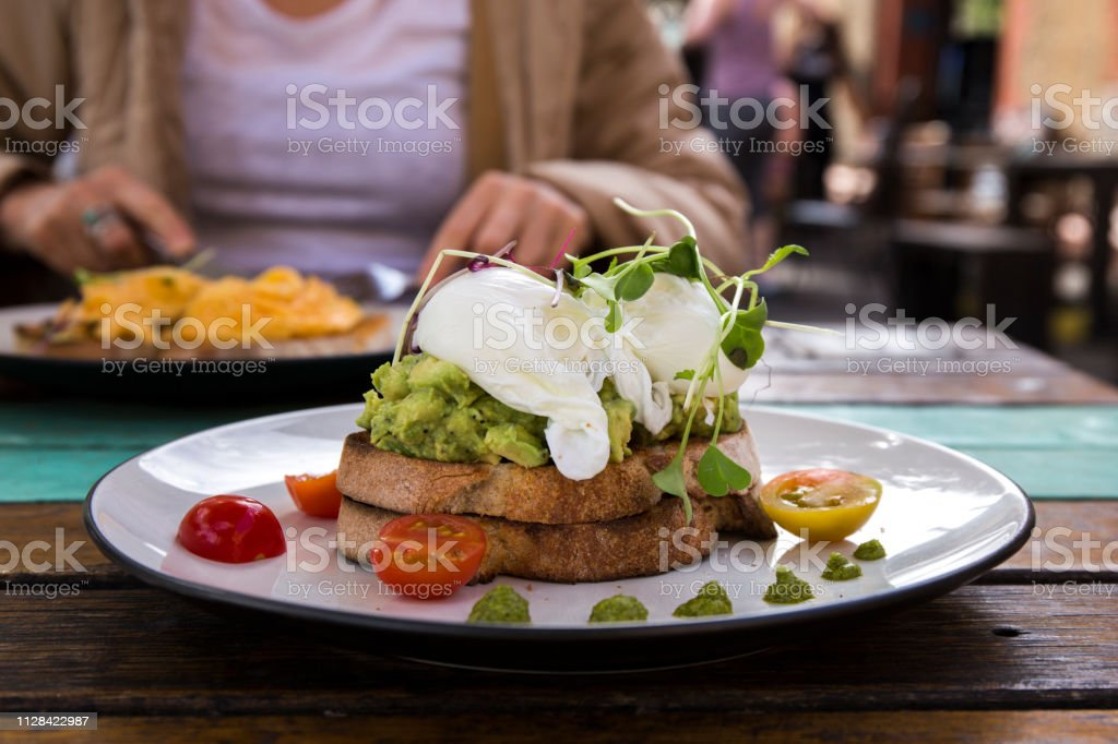 Smashed avocado toast stock photo