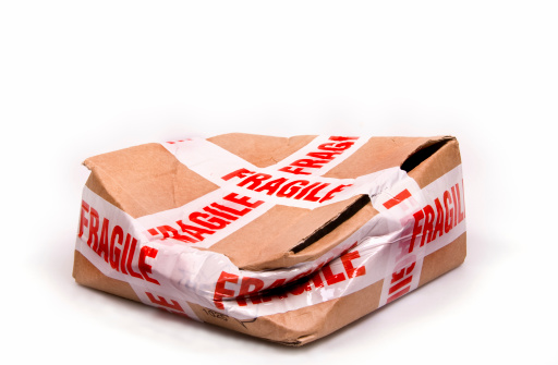 A package wrapped with 'Fragile' tape - instruction clearly ignored!