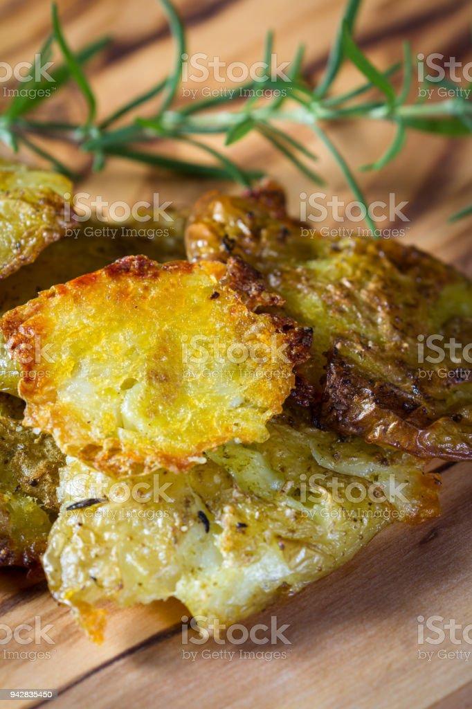 smashed fried potatoes stock photo