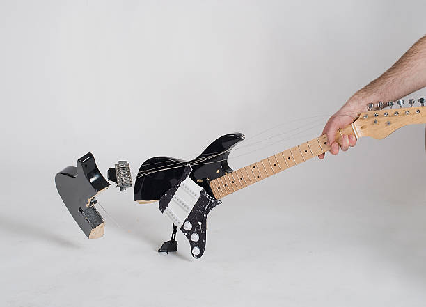 smashed guitar - broken guitar stock photos and pictures