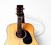 Wooden acoustic guitar isolate on a white background.