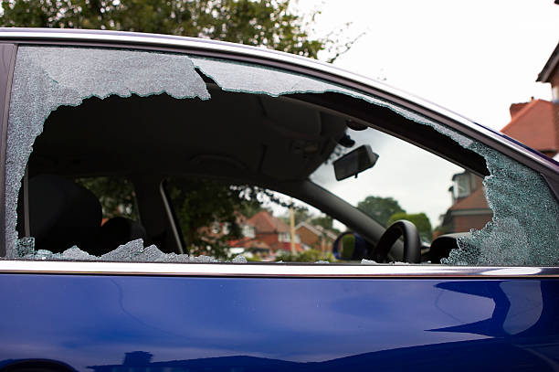 Smashed safety glass in a car door stock photo