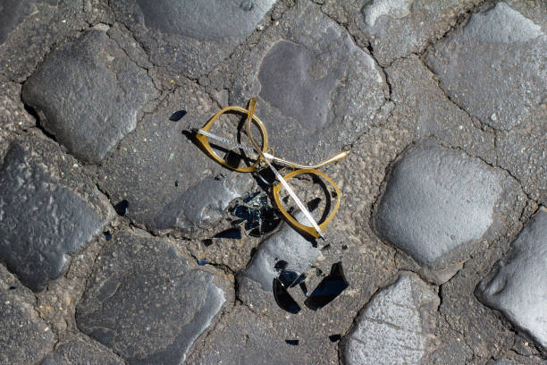smashed sunglasses on stone pavement stock photo