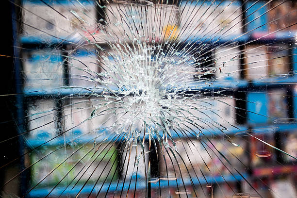 Smashed window with toughened glass stock photo
