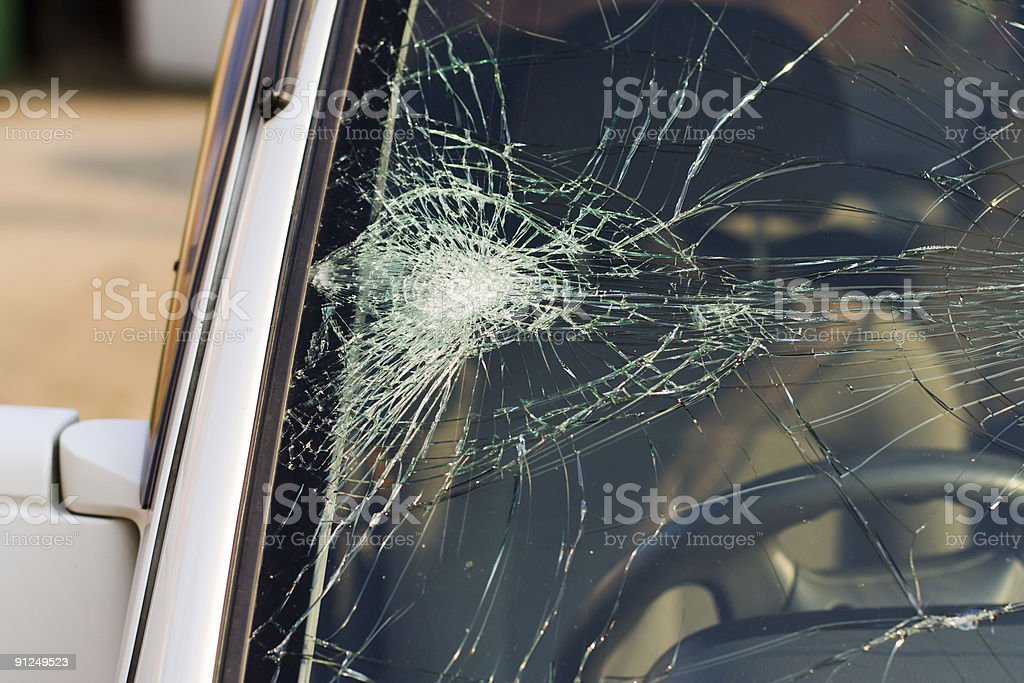 Smashed windscreen of a white car stock photo