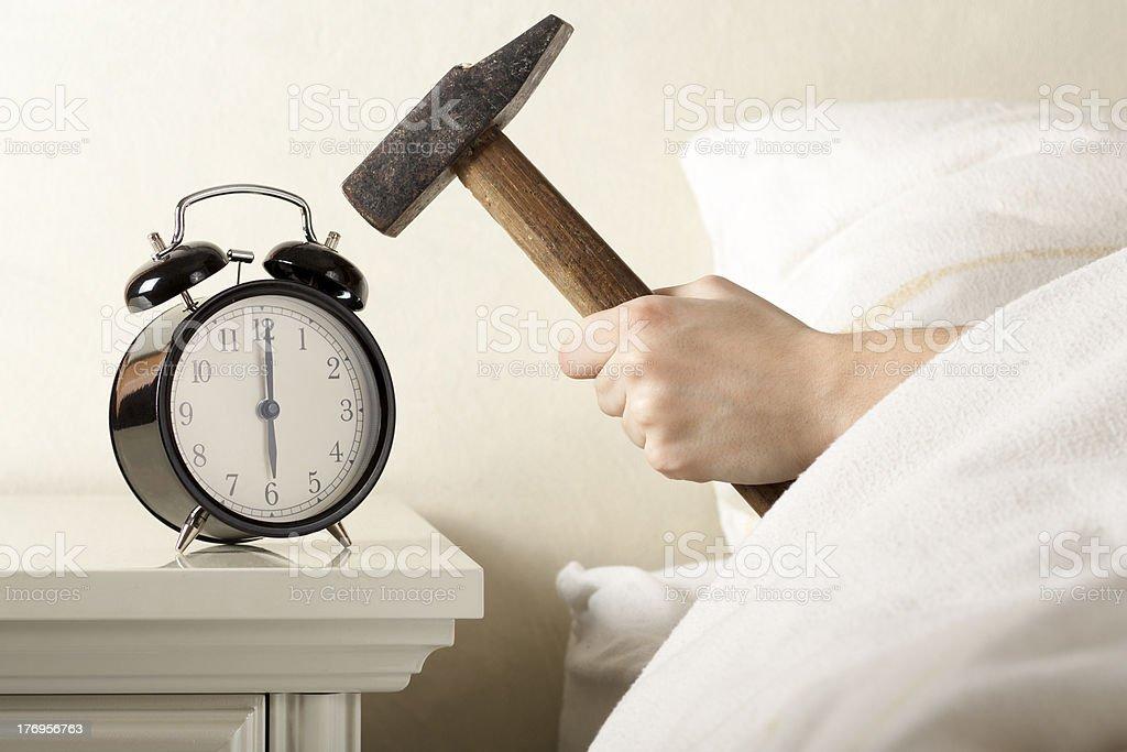 Smashing Alarm Clock with Hammer stock photo