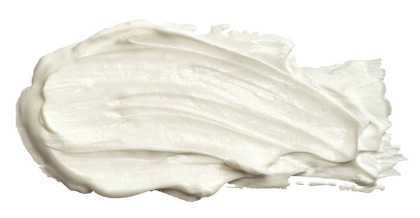 Smear of white face cream texture. A sample of a cosmetic product, body cream. Isolated on white background. stock photo