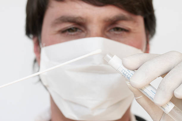 """Smear test """"Doctor performing smear-test with a swab which can be used for various genetic-, bacterial- or viral analysis."""" pap smear stock pictures, royalty-free photos & images"""