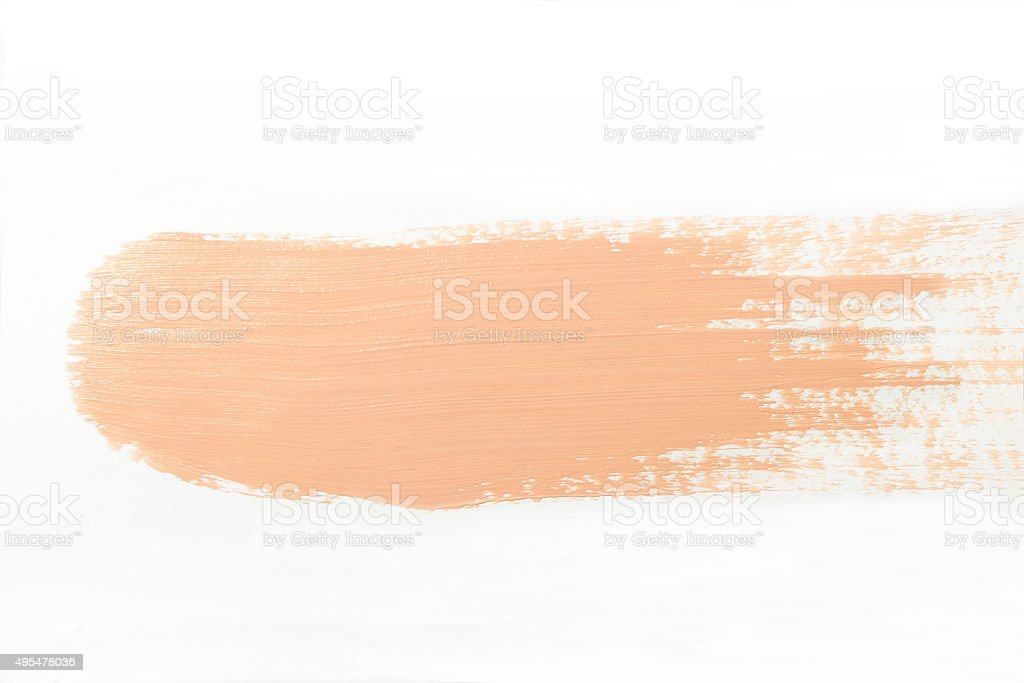 smeared foundation on white background stock photo