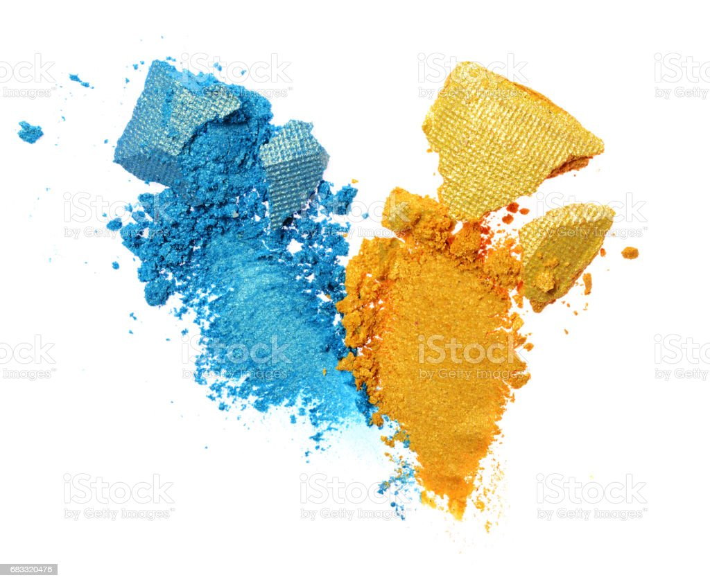 Smears of crushed blue and golden shiny eyeshadow foto stock royalty-free