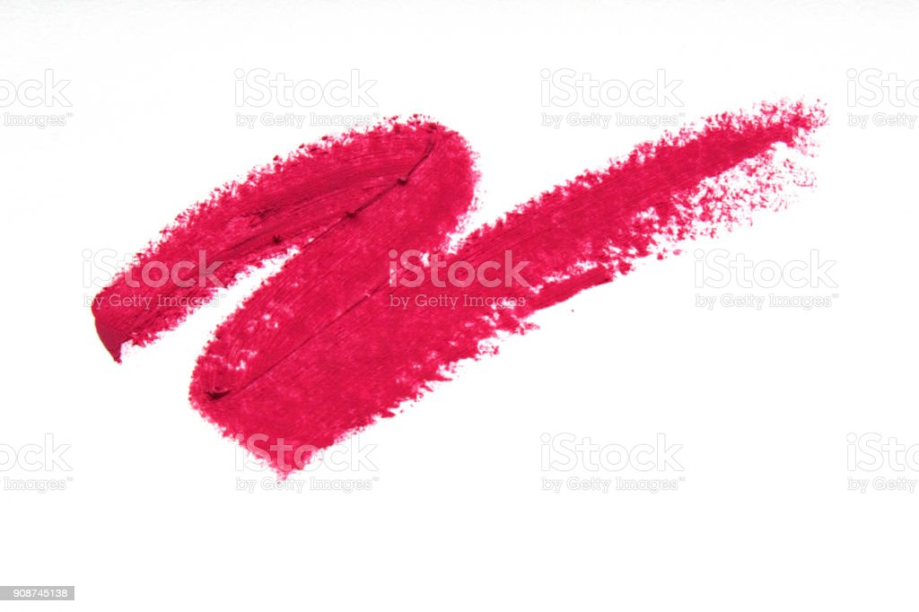 Smears of pink lipstick close-up isolated on white background. Make-up, beauty. stock photo
