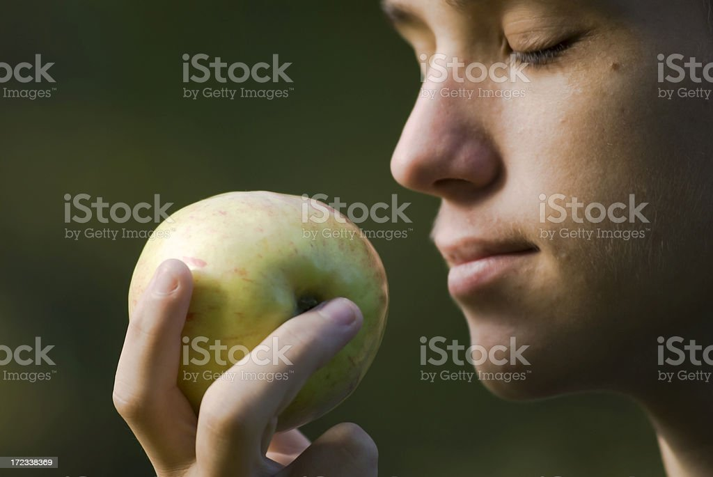 Smell of an apple stock photo